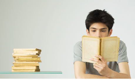 Young-man-reading-a-book-001